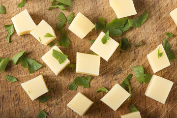 Cubes of fresh cheese with green parsley leaves