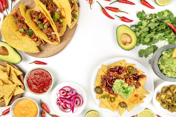 Overhead photo of assortment of Mexican food on white