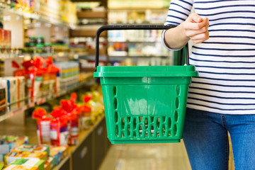 Beautiful Young Woman Groceries Shopping In Local Supermarket
