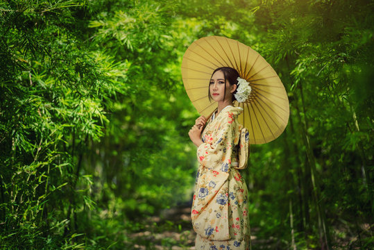 Japanese woman wearing kimono holding umbrella
