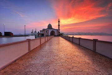 Wall Mural - Fiery sunset over the beautiful mosque
