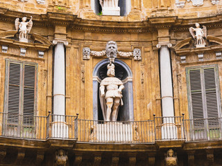 Palermo, Italy April, 2018: Statue of Philip IV at the Quattro Canti, Palermo Baroque facade at the sout-east corner in the historic center of Palermo