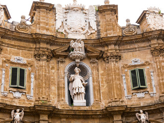 Palermo, Italy April, 2018: Statue of Saint Catherine at the Quattro Canti, Palermo Baroque facade at the sout-east corner in the historic center of Palermo