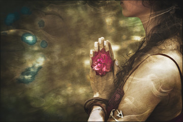 close up of yoga woman hands in namaste gesture with rose flower