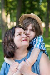 Mom or grandmother calms a son or grandson.