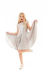 Full length image of Shocked young blonde girl in dress