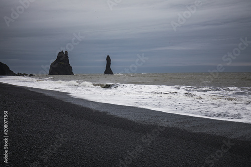 The Waveting Beach At Black Sand In Reynisfjara