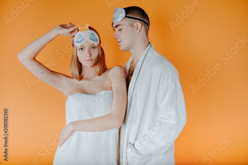 Bearded male and his wife wears white bathrobes and towel on head ... c114272b2