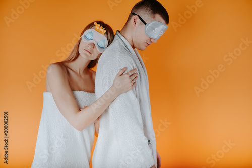 Loving young couple after shower. Close up shot of beautiful woman and her  husband cuddle each other 3cfb3528b