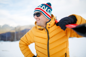 Photo of happy man with mountain skis