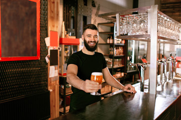 Bartender With Beer In Glass In Pub Wall mural