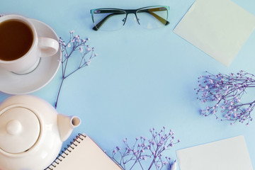 Blue background on which gypsophila, paper, notebook. Valentines day
