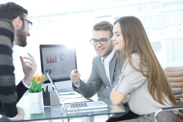 business team discusses the financial documents in the office