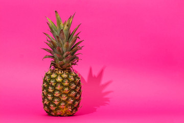 Pineapple in front of pink background