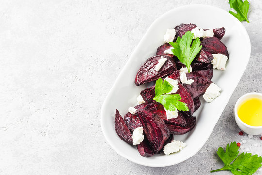 Healthy roasted beetroot feta cheese salad. Selective focus, space for text.