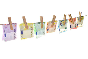Euro banknotes clothes pins Money background