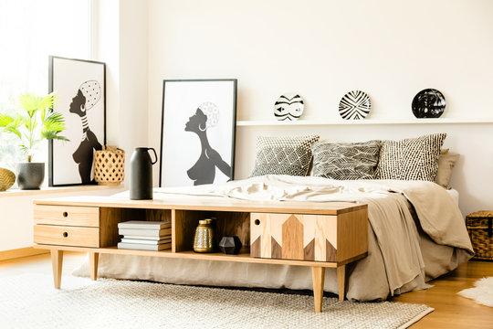 African posters in bedroom interior
