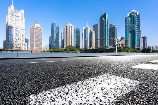 empty asphalt road with office building
