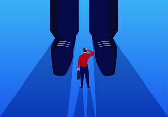 Businessman stands at the feet of giants