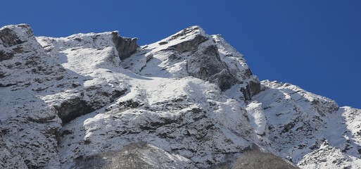 Mountain covered by new snow. Spring scene in the Langtang valley, Nepal.