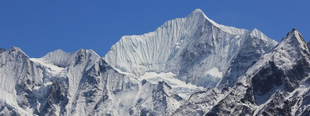 Mount Gangchenpo on a clear spring day after snowfall. High mountain in the Langtang valley, Nepal.