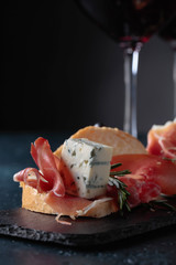 Fototapete - Sandwich with prosciutto, blue cheese and rosemary .