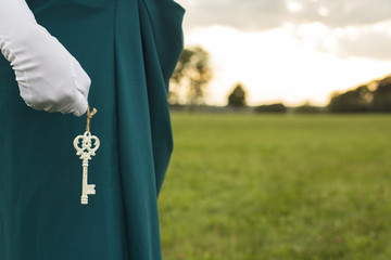 Woman holding key