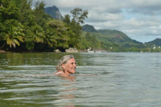beautiful senior woman swimming