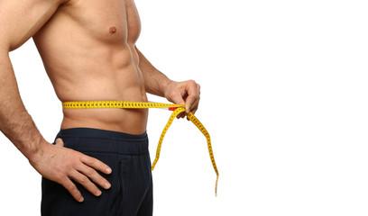 Mann misst Bauchumfang / Diät / Abnehmen