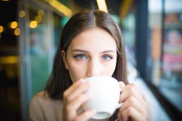 women who is enjoy in cafe