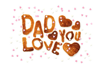 Food typography phrase Dad Love You performed from Alphabet Pancakes with sprinkles