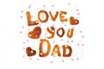 Food typography phrase Love You Dad performed from Alphabet Pancakes with sprinkles