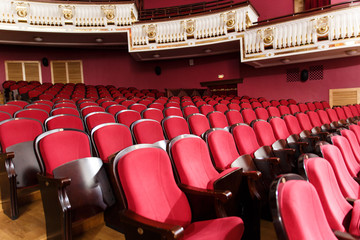 theater hall for visitors with beautiful chairs of Burgundy-red velvet chairs before the show