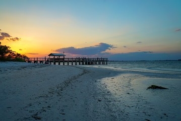 Scenic Golden Sunset at Sanibel Pier in Florida