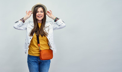 Casual Feashion style portrait of smiling woman wearibg hat with