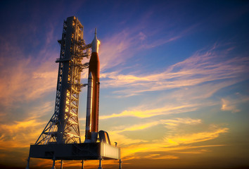 Space Launch System On Launchpad Over Background Of Red Clouds