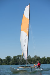 sailing on a lake - summer and sports theme