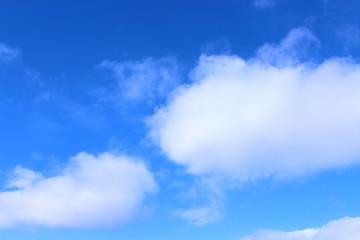 Beautiful blue sky and white cumulus clouds. Background. Landscape.