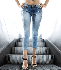 blue woman jeans and gray background.