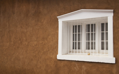 White Wooden Window on Adobe Building in Santa Fe, New Mexico