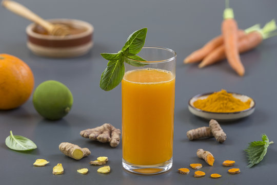 Carrot ginger immune boosting, anti inflammatory smoothie with turmeric and honey. Detox morning juice drink,