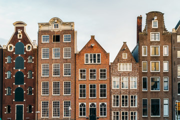 Beautiful Architecture Of Dutch Houses On Amsterdam Canal In Autumn