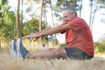 middle-aged man workout in the park