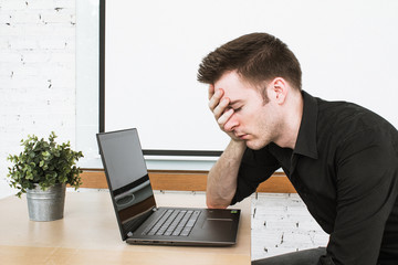 Low energy is coffee time for office worker on laptop.