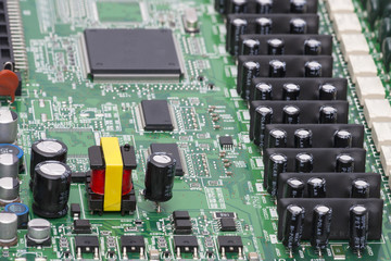 Electronic components are mounted on the device board Chips diodes capacitors chokes Close-up