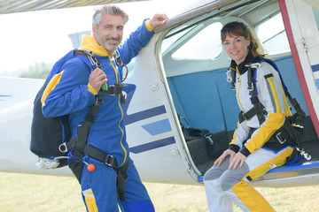 Portrait of male and female parachutists