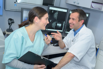 Two medical workers laughing together
