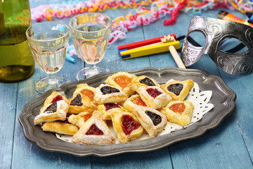 homemade hamantaschen cookies,noise maker and mask, for happy Purim jewish holiday party