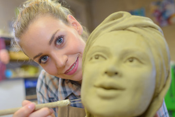 female sculptor in her workshop