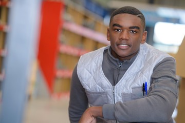 portrait of young man warehouse worker